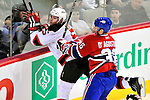 9 January 2010: New Jersey Devils' defenseman Colin White is checked into the boards by Montreal Canadiens right wing forward Matt D'Agostini at the Bell Centre in Montreal, Quebec, Canada. The Devils edged out the Canadiens 2-1 in overtime. Mandatory Credit: Ed Wolfstein Photo