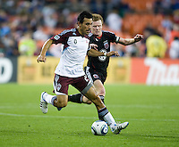 Dax McCarty (10) of D.C. United fights for the ball with Pablo Mastroeni (25) of the Colorado Rapids during the game at RFK Stadium in Washington, DC.  D.C. United tied the Colorado Rapids, 1-1.