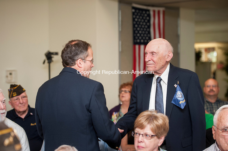 SOUTHBURY, CT-8 May 2015-050815EC03-  Thomas F. Stefenko, with the Office of Advocacy and Assistance for the State of Connecticut's Department of Veterans Affairs, presents a Wartime Service Medal to Domenic Testa. The presentation was part of the unveiling of a Veteran Wall of Honor ceremony at the Southbury Senior Center Friday. The Veteran's Wall of Honor is in the lounge of the senior center. Erin Covey Republican-American