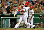 16 August 2008: Washington Nationals' infielder Emilio Bonifacio makes contact during a game against the Colorado Rockies at Nationals Park in Washington, DC.  The Rockies defeated the Nationals 13-6, handing the last place Nationals their 9th consecutive loss. ..Mandatory Photo Credit: Ed Wolfstein Photo