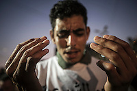 In this Friday, Jul. 12, 2013 photo, a Muslim supporter of the ousted president Mohammed Morsi cries as he offers prayers in the streets nearby Al Rabaa mosque in Nasr City, Cairo. (Photo/Narciso Contreras).