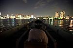 "Aihiro Yasuda steers one of the Yasuda fa,ily-operated Harumiya Co.'s ""yakata-bune"" pleasure boats toward central Tokyo, Japan on 30 August  2010. .Photographer: Robert Gilhooly"