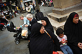 Muslim women rest during shopping in the centre of Leicester City, UK.....Leicester is expected to be the first city in the UK to have a majority non-white population within the next few years. It is one of the most ethnically-diverse cities in Europe. ..