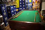 South America, Brazil. Rio de Janiero. Pool table and bar room at the Favela of Vila Canoas.