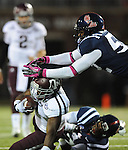Texas A&amp;M running back Ben Malena (1) is tackled by Mississippi linebacker Denzel Nkemdiche (4) and Mississippi defensive end Cameron Whigham (55) in Oxford, Miss. on Saturday, October 6, 2012. (AP Photo/Oxford Eagle, Bruce Newman)..