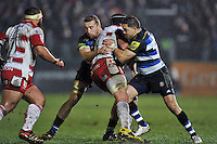 Dom Day and Horacio Agulla of Bath Rugby put in a double-tackle. Aviva Premiership match, between Bath Rugby and Gloucester Rugby on February 5, 2016 at the Recreation Ground in Bath, England. Photo by: Patrick Khachfe / Onside Images