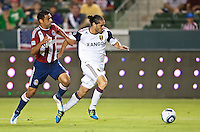 CARSON, CA – August 27, 2011: Chivas USA defender Ante Jazic (13) and Real Salt Lake forward Fabian Espindola (7) during the match between Chivas USA and Real Salt Lake at the Home Depot Center in Carson, California. Final score Chivas USA 0, Real Salt Lake 1.