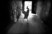 Wroclaw 08.12.2006 Poland<br /> The worst and the most dangerous district in Wroclaw ( Poland ) , called by people &quot;The Bermuda Triangle&quot;. There are walls bearing an inscription &quot;Who will enter here, will not exit alive&quot; Many families there are pathological and live in extreme poverty. Children have no place for any games so they loaf around on this wasted district and disseminate a juvenile delinquency. Many of them become sexually active though they are only 10-12 years old<br /> (Photo by Adam Lach / Napo Images)<br /> <br /> Najbardziej nabezpieczna dzielnica we Wroclawiu zwana przez ludzi Trojkatem Bermudzkim. Sa tam sciany opatrzone napisem &quot; Kto tu wejdzie, nigdy nie wyjdzie stad zywy&quot; Mieszka tam wiele rodzin patologicznych i zyja w wielkiej nedzy. Dzieci wlocza sie po ulicach nie majac miejsc na zabawe i szerza przestepczosc wsrod nieletnich. Wiele z dzieci uprawia seks choc maja zaledwie 10-12 lat<br /> (Fot Adam Lach / Napo Images)