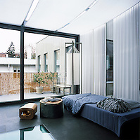 A relaxing living space leads out to a balcony terrace area
