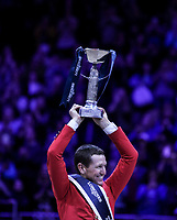 OMAHA, NEBRASKA - APR 2: McLain Ward holds up the World Cup trophy after winning the Longines FEI World Cup Jumping Final at the CenturyLink Center on April 2, 2017 in Omaha, Nebraska. (Photo by Taylor Pence/Eclipse Sportswire/Getty Images)