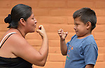 Teofila Alonso Martinez speaks in sign language with Felipe de Jesus Piña Alonso, her 6-year old son who is deaf, at Piña Palmera, a center for community based rehabilitation for people living with disabilities in Zipolite, a town in Oaxaca, Mexico.