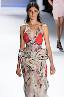 Jacquelyn Jablonski walks runway in a magenta psychedelic printed chiffon tiered high-low gown with peplum drawstring belt.by Vera Wang, for the Vera Wang Spring 2012 collection, during Mercedes-Benz Fashion Week Spring 2012.
