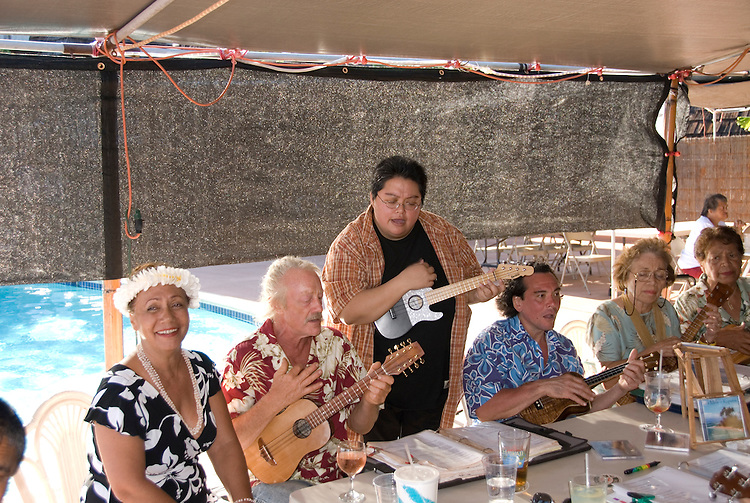 Hawaii: Molokai, Friday night entertainment by locals at the Hotel Molokai, with singers, ukulele strummers, hula dancers, and good food and drink. .Photo himolo172-71773.Photo copyright Lee Foster, www.fostertravel.com, lee@fostertravel.com, 510-549-2202