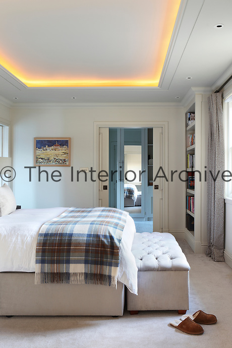 A white, grey and beige palette, clever lighting and simple accessories make for a dream scheme in this spacious bedroom.