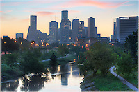 In the early morning of late September, this is the Houston skyline from a pedestrian Bridge that spans both Buffalo Bayou and Memorial Parkway. Downtown highrises begin to awaken in the largest city in Texas. This photograph was a mix of several exposures in order to get the light just right.
