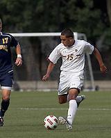Boston College forward/midfielder Diego Medina-Mendez (15) brings the ball forward. Boston College defeated Quinnipiac, 5-0, at Newton Soccer Field, September 1, 2011.
