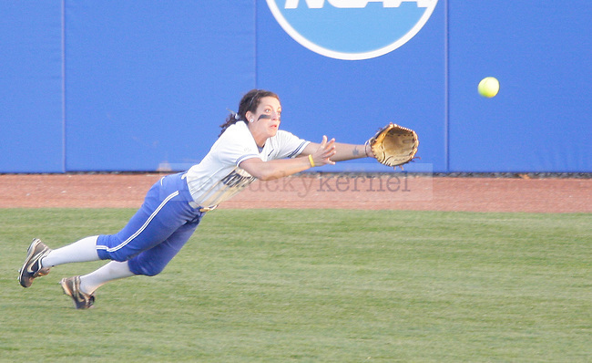 Sophomore infielder Ginny Carroll dives for a ball at the UK vs. University of Louisville softball game at the Softball Complex in Lexington, Ky., on Wednesday, March 28, 2012. Photo by Tessa Lighty | Staff