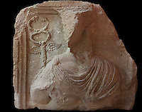 Relief of an unidentified figure with a winged symbol over the right shoulder, from the Petra Archaeological Museum, Petra, Ma'an, Jordan. Petra was the capital and royal city of the Nabateans, Arabic desert nomads. Picture by Manuel Cohen