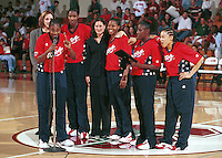 STANFORD, CA - NOVEMBER 1: Jennifer Azzi of the Stanford Cardinal is presented a plaque by the USA National Team during an exhibition game against the USA Team on November 1, 1999 at Maples Pavilion in Stanford, California.