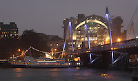 Hungerford Bridge with floodlit Charing Cross station in the background, 1990, Terry Farrell and Partners, seen from the South Bank of the river Thames, London, UK. Picture by Manuel Cohen