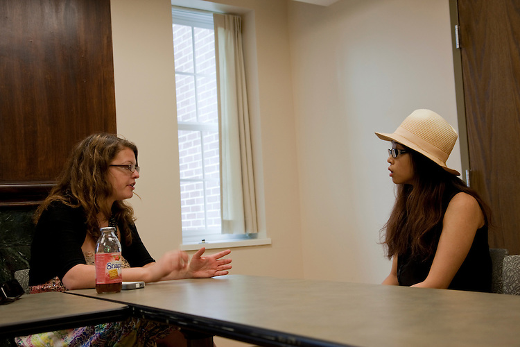 Kara Kauffman talks to Xi Mao during a walk in advising session at the Walter International Education Center