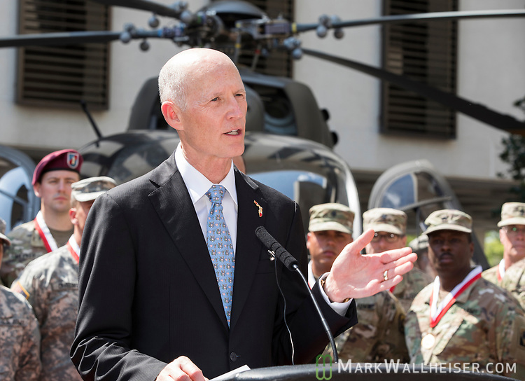 """Florida Governor Rick Scott speaks during the Florida Department of Military Affairs and the Florida National Guard sponsored """"Florida National Guard Day"""" at the Capitol"""