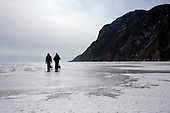 Misha and Nastya trek near the Olkhon Island after crossing the frozen Lake Baikal in Siberia, Russia. (Third Day)..They are a group of five people: Justin Jin (Chinese-British), Heleen van Geest (Dutch), Nastya and Misha Martynov (Russian) and their Russian guide Arkady. .They pulled their sledges 80 km across the world's deepest lake, taking a break on Olkhon Island. They slept two nights on the ice in -15c. .Baikal, the world's largest lake by volume, contains one-fifth of the earth's fresh water and plunges to a depth of 1,637 metres..The lake is frozen from November to April, allowing people to cross by cars and lorries.