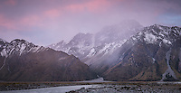 Dusk over Tasman River flats with mountains and Gorilla Stream in centre, Aoraki, Mt. Cook National Park, UNESCO World Heritage Area, Mackenzie Country, New Zealand, NZ