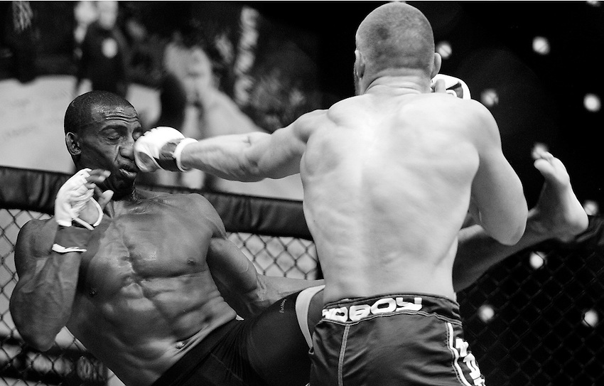 ATLANTIC CITY, NJ - (Aug. 17, 2013) - Mixed martial arts fighter Bradley Desir (left) is knocked off his feet by Christian Leonard, right, with a straight left to the nose during the second round of their 155-pound boat at Cage Fury Fighting Championship 26 in Atlantic City.