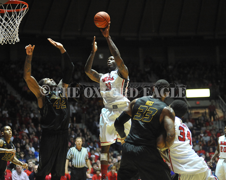 "Ole Miss' Murphy Holloway (31) vs. Missouri's Alex Oriakhi (42) at the C.M. ""Tad"" Smith Coliseum on Saturday, January 12, 2013. Ole Miss defeated #10 ranked Missouri 64-49."