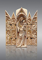 Medieval Gothic ivory tabernacle depicting the Virgin and Child with scenes from the Annunciation, Nativity, the adoration of the Magi and the presentation at the Temple  made in Paris in second quarter of the 14th century and is a typical example of tabernacles made in Paris at that period.  inv 2587, The Louvre Museum, Paris.