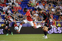Danny Welbeck (19) of Manchester United plays the ball as Geoff Cameron (20) of the MLS All-Stars chases. Manchester United defeated the MLS All-Stars 4-0 during the MLS ALL-Star game at Red Bull Arena in Harrison, NJ, on July 27, 2011.