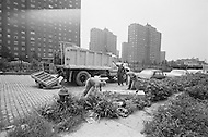 September 1967 --- Workers Picking Up Garbage in New York City --- Image by © JP Laffont/Sygma/CORBIS