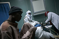 November 22, 2014 - Murzuq City, Libya: Tebu men receive medical treatment in the emergency ward at the local hospital in Murzuq. Fighting around Southwest Ubari region ignited after Tuareg militias from Mali and Libya sized control over the vast oilfield installations aligned with the Third Force of Misrata armed forces. Since then raged battles have taken place between two factions: one faction of Tuareg fighters lead by Third Force from Misrata pushing to clean the region from the other faction of Tebu tribal fighters defending their controlled territory. (Photo/Narciso Contreras)