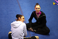 (L-R) Anna Bessonova and Galina Shyrkina of Ukraine share happy moments during warmups before San Francisco Invitational on February 11, 2006. Bessonova won All-Around competition. (Photo by Tom Theobald)