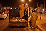10/10/2014 -- Kirkuk, Iraq -- Bangladeshi workers clean the street at night in Iskan neighborhood in north Kirkuk.