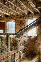 Hay shoot in a rustic barn.
