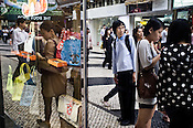 Tourists shop in Central Macau, China.