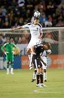 LA Galaxy defender Omar Gonzalez (4) goes up high to head the ball during the first half of the game between LA Galaxy and the D.C. United at the Home Depot Center in Carson, CA, on September 18, 2010. LA Galaxy 2, D.C. United 1.