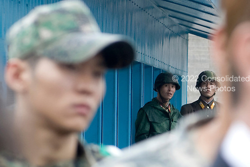 North Korean soldiers watch as South Korean Foreign Minister Yu Myung-hwan United States Secretary of State Hillary Rodham Clinton, U.S. Secretary of Defense Robert Gates and South Korean Defense Minister Kim Tae-young speak to members of the press outside the T2 buildings in Panmunjom, the demilitarized zone that separates the two Koreas since the Korean War, north of Seoul, South Korea, Wednesday, July 21, 2010.  .Mandatory Credit: Cherie Cullen - DoD via CNP
