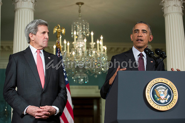 United States Secretary of State John Kerry , left, looks on as US President Barack Obama, right, makes a statement after meeting with his National Security Council at the State Department, February 25, 2016 in Washington, DC. The meeting focused on the situation with ISIS and Syria, along with other regional issues. Photo Credit: Drew Angerer/CNP/AdMedia