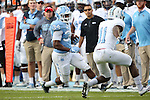 19 November 2016: UNC's Elijah Hood (34) and The Citadel's Ben Roberts (11). The University of North Carolina Tar Heels hosted the The Citadel, The Military College of South Carolina Bulldogs at Kenan Memorial Stadium in Chapel Hill, North Carolina in a 2016 NCAA Division I College Football game. UNC won the game 41-7.