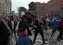 Anti-Hosni Mubarak protesters throw rocks and bricks at nearby Mubarak supporters as they defend the Tahrir square area February 03, 2011 where they have remained for a week following massive and unprecedented demonstrations. . .Photo by Scott Nelson