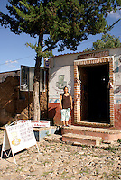 Griselda Gomez standing outside her handicrafts store in the 19th century mining town of Mineral de Pozos, Guanajuato, Mexico.