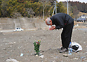 March 11, 2012, Rikuzentakata, Japan - A lone Japanese offers a prayer on an empty lot where his friend's home once was  in  Rikuzentakata, Iwate Prefecture, some 402 km northeast of Tokyo, on Sunday, March 11, 2012..Memorial ceremonies were held throughout Japan to mark the one year anniversary of the massive earthquake and tsunami that struck the country?fs northeastern region, killing just over 19,000 people and unleashing the world?fs worst nuclear crisis in a quarter century. The quake was the strongest recorded in the nation?fs history, and set off a tsunami that towered more than 65 feet in some spots along the northeastern coast, destroying thousands of homes and wreaking widespread destruction. (Photo by Natsuki Sakai/AFLO) AYF -mis-