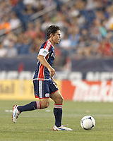 New England Revolution substitute midfielder Kelyn Rowe (11) dribbles. In a Major League Soccer (MLS) match, Montreal Impact defeated the New England Revolution, 1-0, at Gillette Stadium on August 12, 2012.