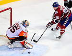 24 November 2008:  New York Islanders' goaltender Joey MacDonald makes a save against the Montreal Canadiens at the Bell Centre in Montreal, Quebec, Canada. The Canadiens, celebrating their 100th season, fell to the visiting Islander 4-3 after an overtime shootout. ****Editorial Use Only****..Mandatory Photo Credit: Ed Wolfstein Photo *** Editorial Sales through Icon Sports Media *** www.iconsportsmedia.com