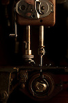 Antique sewing machine close up of needle