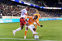 Juan Agudelo (17) of the New York Red Bulls and Corey Ashe (26) of the Houston Dynamo battle for the ball along the end line. The New York Red Bulls  and the Houston Dynamo played to a 1-1 tie during a Major League Soccer (MLS) match at Red Bull Arena in Harrison, NJ, on April 02, 2011.