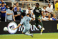 Jorge Perlaza (15) forward Portland Timbers puts the ball around Roger Espinoza Sporting KC... Sporting Kansas City defeated Portland Timbers 3-1 at LIVESTRONG Sporting Park, Kansas City, Kansas.
